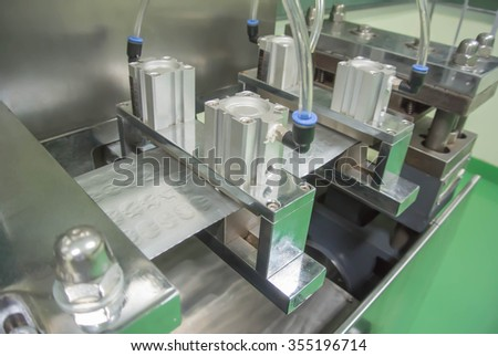 blister packing machine in pharmaceutical industrial,food supplement,soft gelatin capsule filling - stock photo