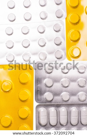 Blisters with pills on a white background for the treatment of diseases - stock photo