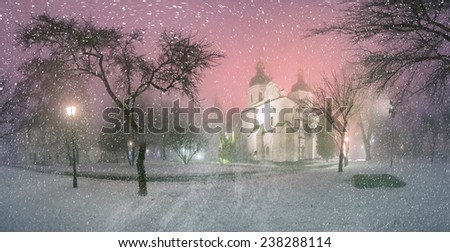 Blizzard and rain enveloped Kiev, bad weather a bad review -  ancient St. Sophia Cathedral, background of the ancient walls and trees bashen- monastic park and garden, beautiful illumination at night - stock photo
