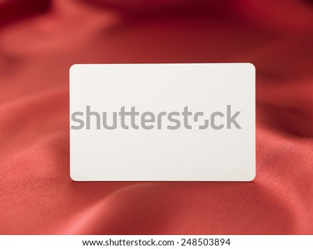 blnk card on the red satin