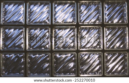 Block made of glass. Take a photo by using light in the afternoon.By using filters film in the colors of the image. - stock photo