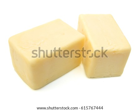 Block of cheddar cheese isolated on white