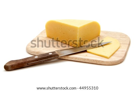 block of cheese on cutting board with a knife, isolated on white background - stock photo
