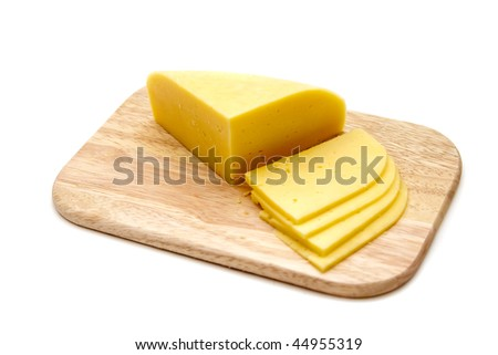 block of cheese with cut pieces on a cutting board, isolated on white background