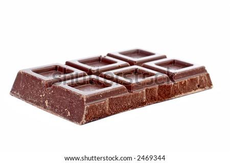Block of fine chocolate on white background. Shallow DOF - stock photo