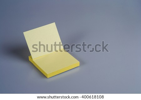 Block of yellow Post it Notes on white background - stock photo