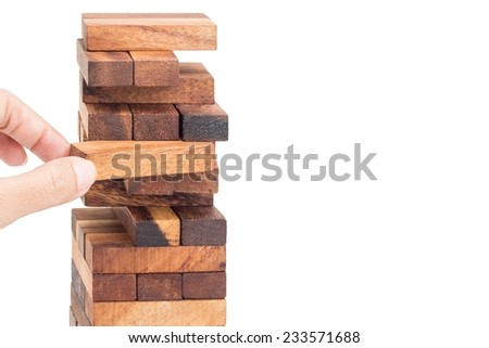 Blocks of wood and hand isolated on white background, - stock photo