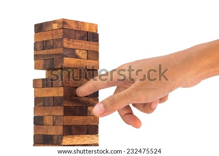 Blocks of wood and hand isolated on white background,Strategy game. - stock photo