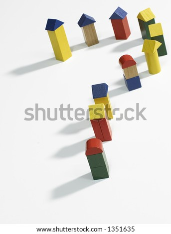 Blocks representing buildings in a question mark shape - stock photo