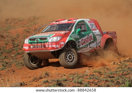 BLOEMFONTEIN, SOUTH AFRICA - OCTOBER 15: Duncan Vos and Rob Howie in their Toyota Hilux in action during a South African off road championship event, Bloemfontein, South Africa, 15 October 2011
