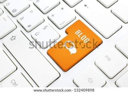 Blog business concept, text and icon. Orange enter button or key on white keyboard photography. - stock photo