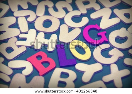 Blog Colored Sign Among Different Uncolored Letters On Green Background, Top View, Close Up - stock photo