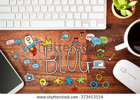 Blog concept with workstation on a wooden desk  - stock photo