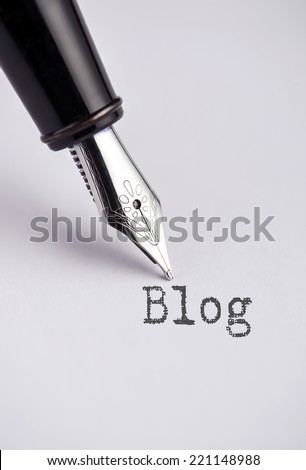 Blog with pen written on paper  - stock photo