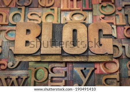 blog word in wood type against background of letterpress printing blocks - stock photo