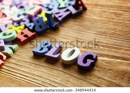 BLOG  - word made from multicolored child toy  letters on wooden  background - stock photo