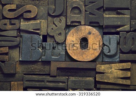 blog word made from wooden letterpress blocks inside many letters background - stock photo