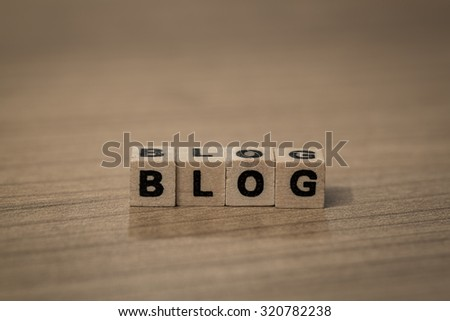 Blog written in wooden cubes on a desk - stock photo