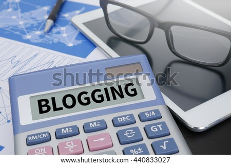 BLOGGING Calculator on table with Office Supplies