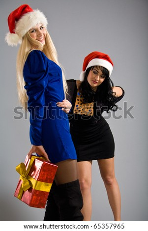 Blond and brunette playing christmas games