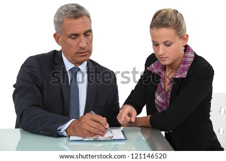Blond assistant helping boss - stock photo