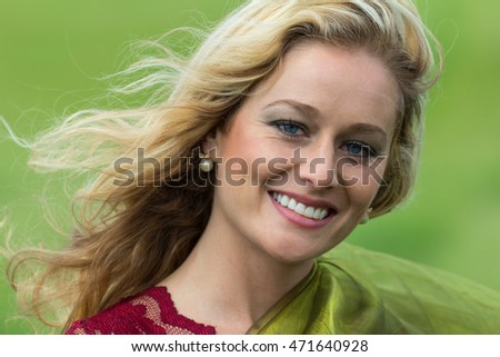 blond beautiful woman close up portrait in the outdoor breeze,