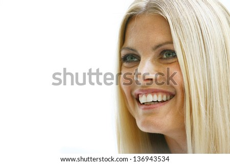 Blond beautiful woman face close-up with natural make-up