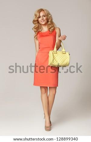 Blond beauty wearing dress - stock photo