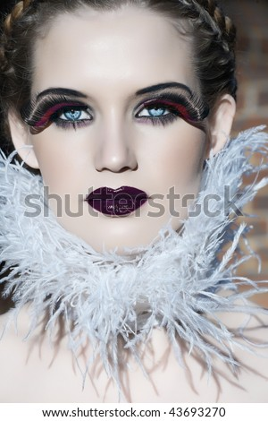 blond beauty with pale skin and goth make-up - stock photo