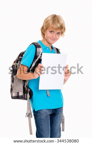 blond boy in front of white background with good report card - stock photo