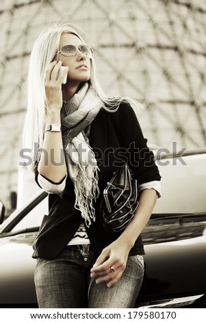 Blond business woman calling on the cell phone  - stock photo