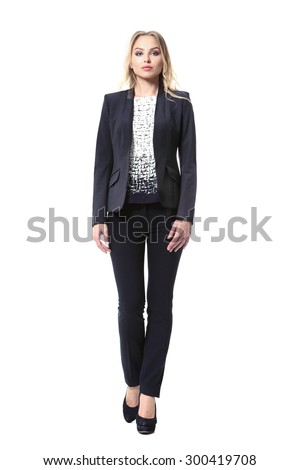 blond business woman in casual clothes jacket and black trousers - stock photo