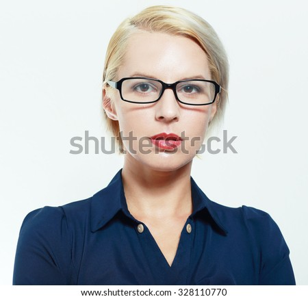 blond business woman in glasses with short haircut - stock photo
