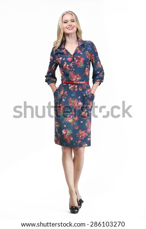 blond business woman in summer floral printed dress isolated on white