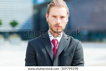 Blond businessman portrait in a modern setting - stock photo