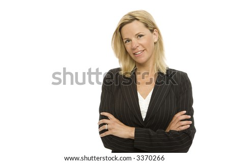Blond businesswoman crosses her arms with confidence