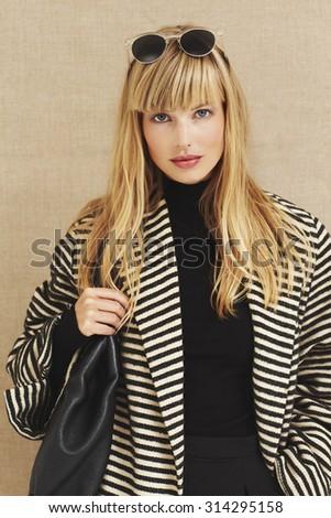 Blond businesswoman in portrait - stock photo