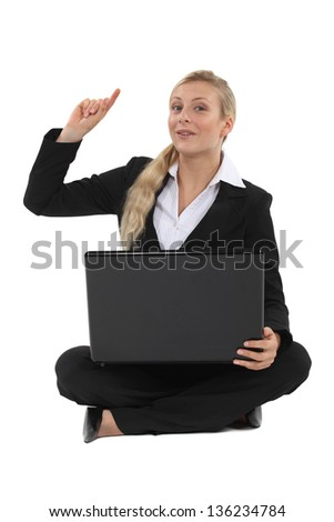 Blond businesswoman raising hand with question - stock photo