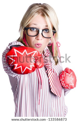 Blond businesswoman training to pack a punch with boxing gloves, white background