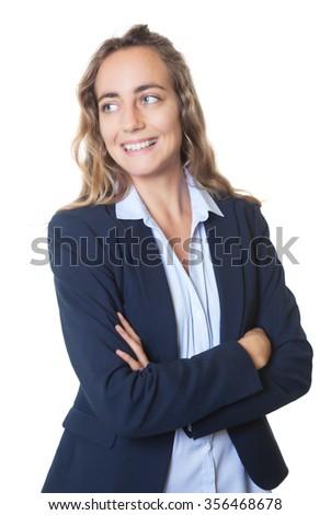Blond businesswoman with blue eyes and blazer looking sideways - stock photo