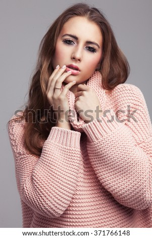 Blond cheerful young woman. Beauty portrait, perfect makeup. Long chic elegant hair. Model tests. Cute girl in white. Sexy fashion woman. Close-up. Pink pullover. - stock photo