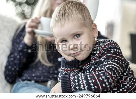 Blond Child looking at camera - stock photo