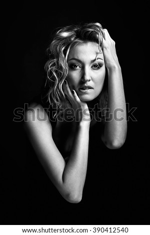 Blond  dramatic sensual romantic  beautiful woman portrait, posing with  hands, bites her lips, actress, fashion model, black and white photography - stock photo