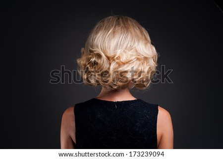 blond fashion girl on a black background - stock photo