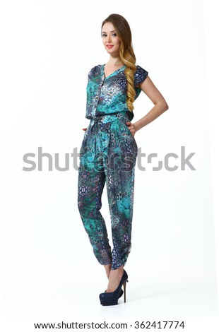 blond fashion model girl in summer emerald green floral printed overall high heels black shoes standing full body portrait isolated on white