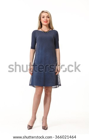 blond fashion model girl with long straight hair style in blue long dress and high heel boots full body length portrait isolated in white - stock photo