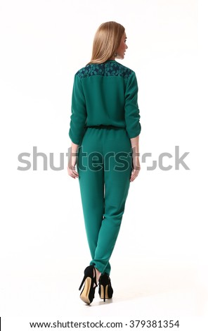 blond fashion model girl with long straight hair style in emerald green overall and high heels black shoes full length body portrait standing isolated on white back view - stock photo