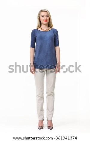 blond fashion model girl with straight long hair style in blue t-shirt blouse white trousers high heel shoes stand full body portrait isolated on white - stock photo