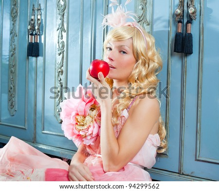 blond fashion princess eating apple with spring flowers dress on blue wardrobe