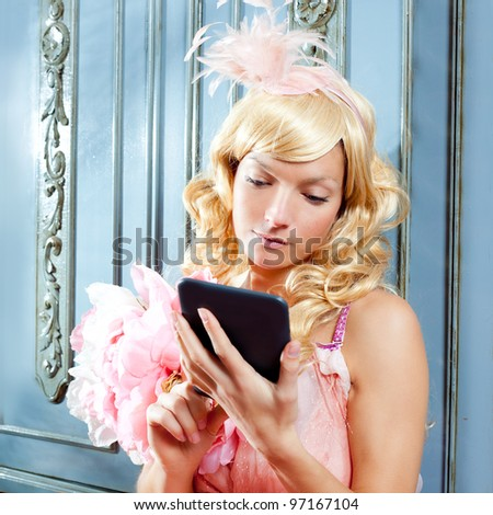 blond fashion princess woman reading ebook tablet with retro spring pink dress
